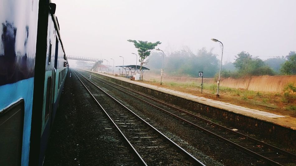 Best mornings... First Eyeem Photo Konkandiaries Konkanrailways Indianrailways Indianphotography Foggy Morning Railroad Track No People Water The Way Forward Outdoors Tree Day Sky