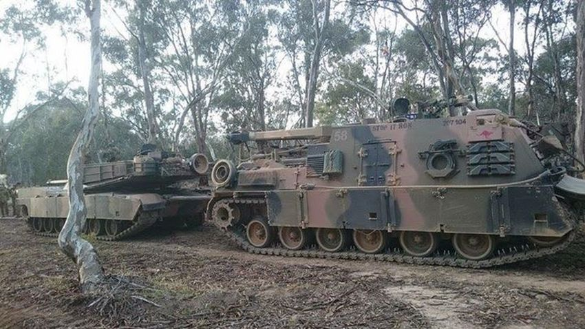 Australian army recovery vehicle pulling an M1A1 Abrams tank Australia Adf Australian Army M1a1 Abrams Army Tanks Tank Military