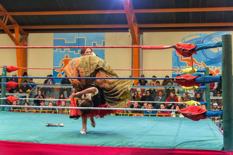 EL ALTO, BOLIVIA - AUGUST 10: Two indigenous women wrestling in El Alto, Bolivia on August 10, 2014 BIG Bolivia Cholita Cholitas Colorful Culture Edge El Alto Fashion Female Fight La Paz Lucha Libre Only Paz People Ring Show Sport Street Travel Women Wrestle  Wrestler Wrestling
