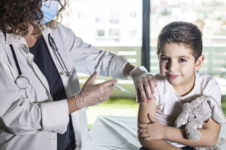 Little boy getting vaccinated from covid-19