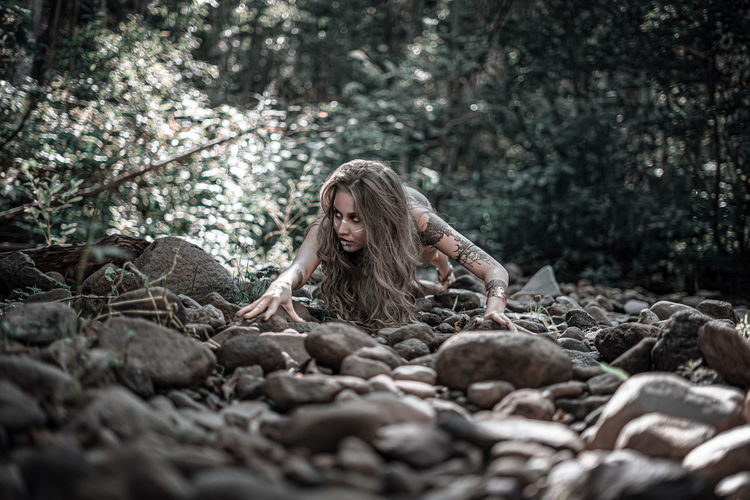 Surface level of woman in forest