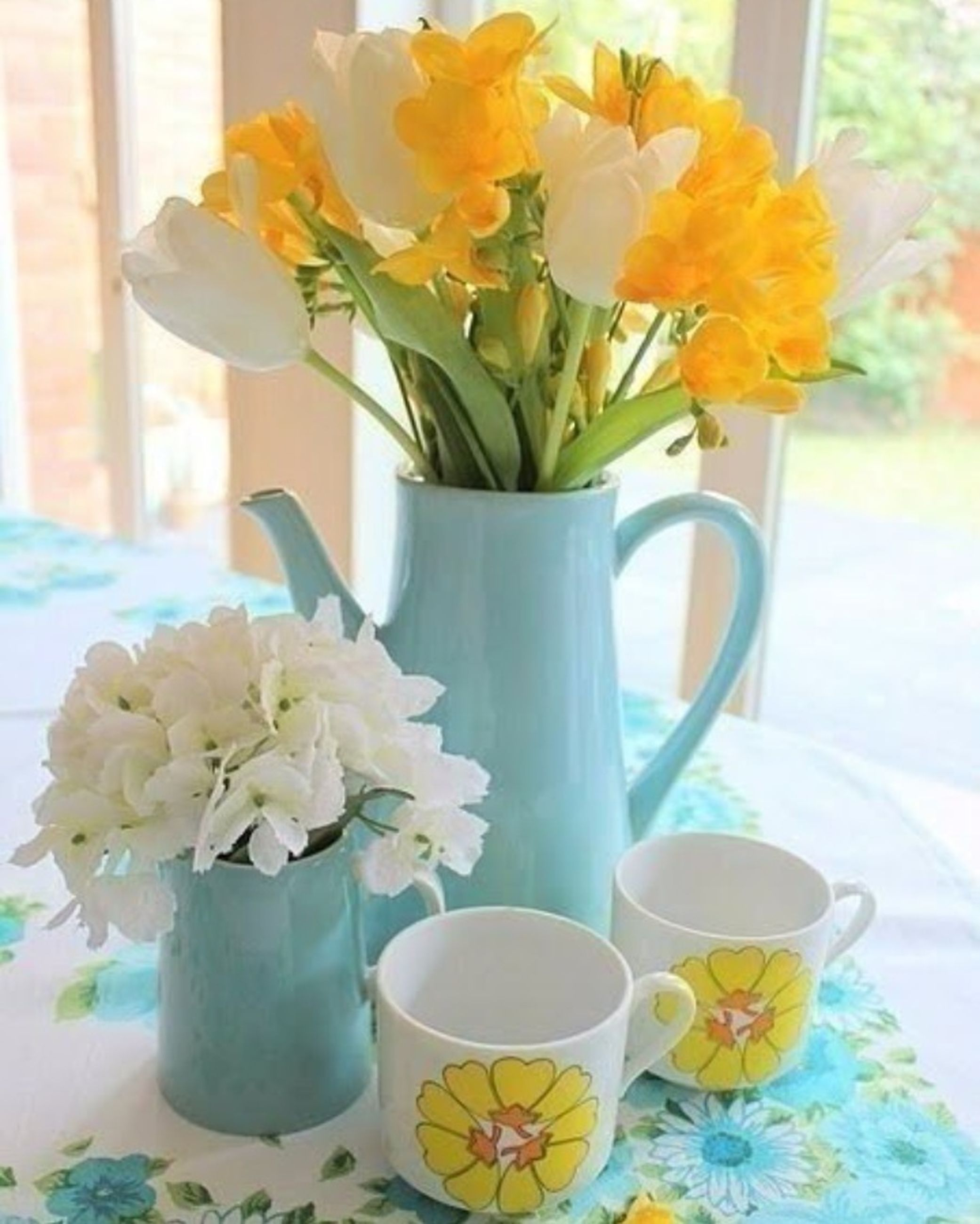 flower, vase, indoors, freshness, petal, fragility, flower head, table, potted plant, flower arrangement, flower pot, growth, home interior, plant, beauty in nature, yellow, window, glass - material, close-up, window sill