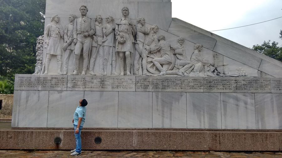 Full length of man looking at monument