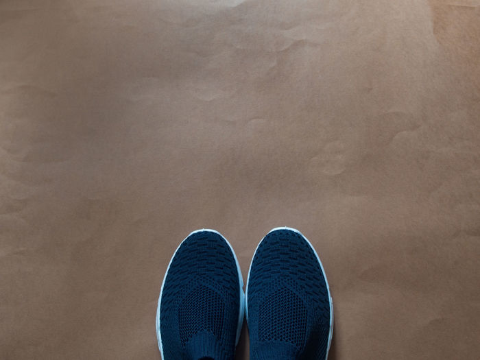 Directly above shot of shoes on brown paper