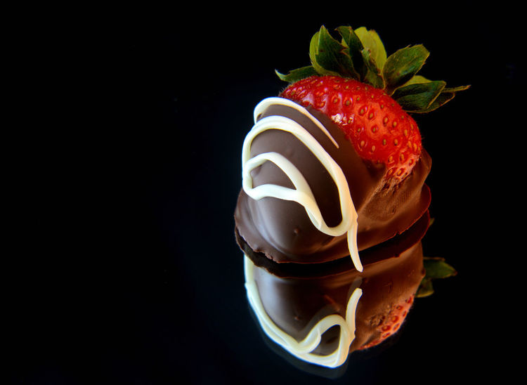 Black Background Chocolate Chocolate Covered Close-up Dessert Food Food And Drink Freshness Fruit Indulgence No People Ready-to-eat Reflection Strawberry Sweet Food Temptation Visual Feast Food Stories