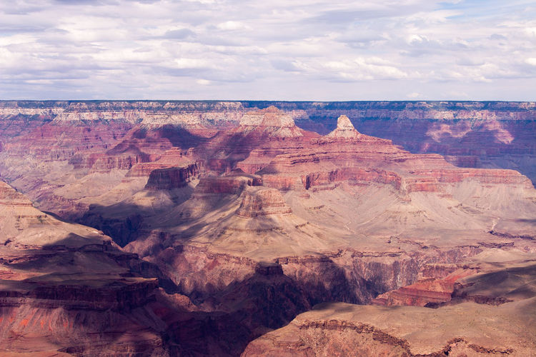 Beautiful view of the Grand Canyon EyeEmNewHere Grand Canyon Beauty In Nature Canyon Climate Cloud - Sky Environment Eroded Formation Geology Landscape Nature No People Non-urban Scene Outdoors Physical Geography Rock Rock - Object Rock Formation Scenics - Nature Sky Solid Tranquil Scene Tranquility Travel Travel Destinations Wallpaper