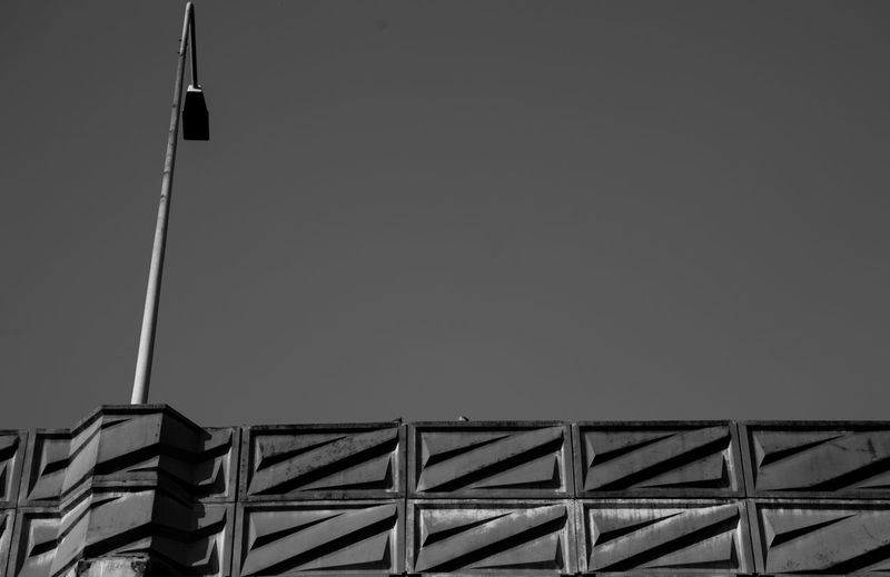 Architecture Sky Low Angle View Built Structure Copy Space No People Building Exterior Building Day Clear Sky Outdoors Construction Site Construction Industry Roof Metal Lighting Equipment Pole Pattern Flag B/w B/W Photography Workshop Streetphotography Streetphoto_bw Bridge