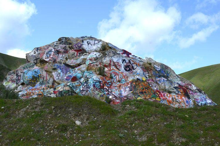 Graffiti Rock - Highway 130 in Rural CA Rock Graffiti Sky Grass Cloud - Sky Countryside Spray Paint ArtWork
