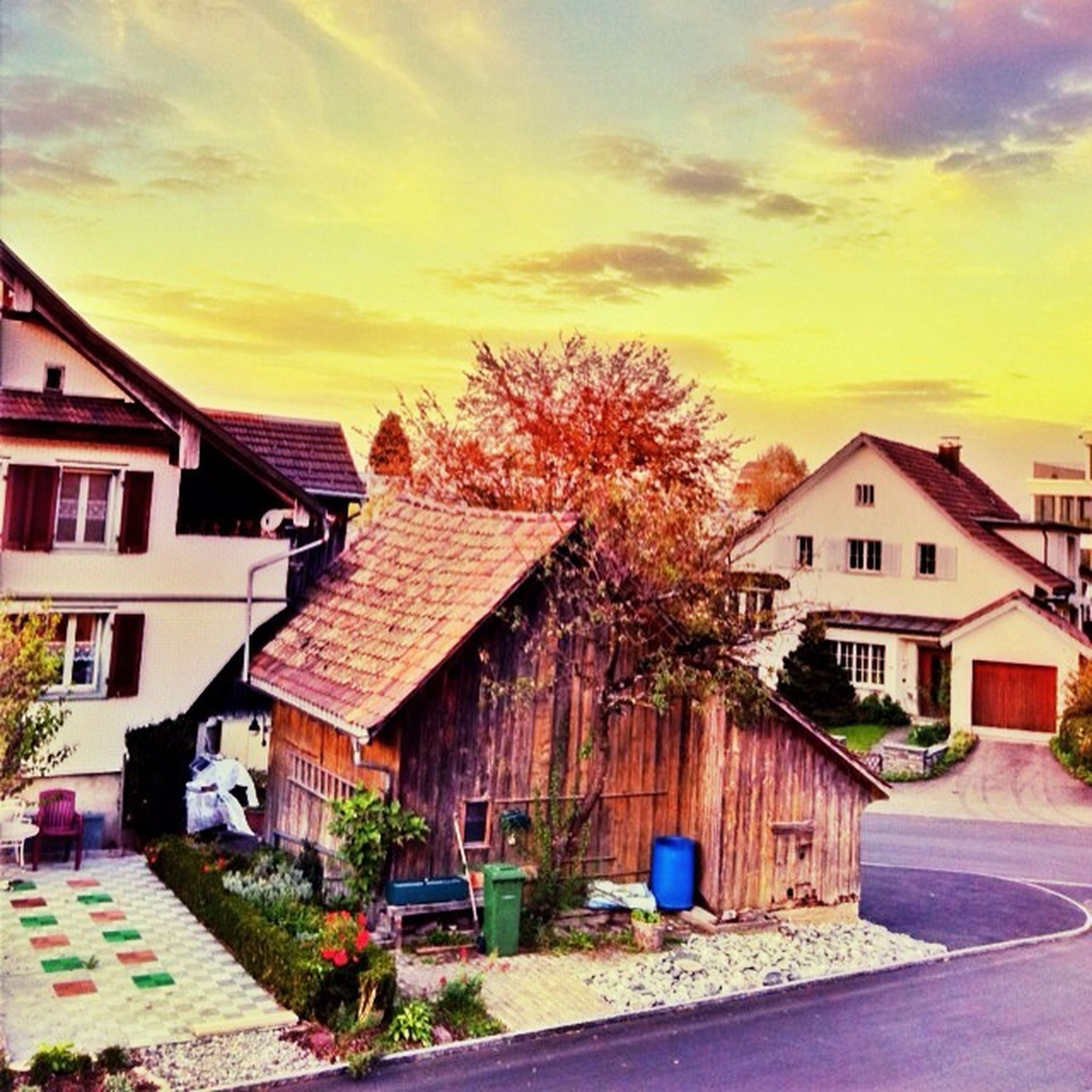 building exterior, architecture, built structure, house, residential structure, residential building, sky, sunset, tree, cloud - sky, street, orange color, city, residential district, building, outdoors, town, road, cloud, no people