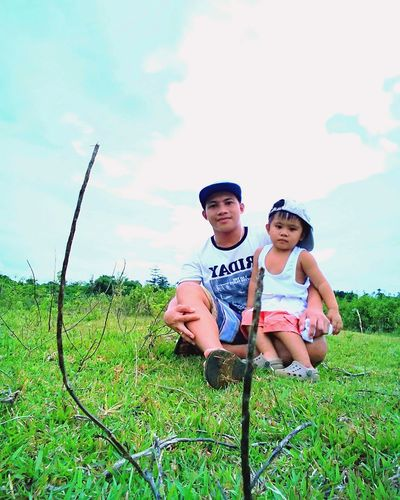EyeEmNewHere Child Boys Togetherness Two People Day Males  Looking At Camera Grass People Childhood First Eyeem Photo EyeEm Selects Casual Clothing Outdoors Sky Plant Cap Standing Adult Portrait Baseball - Sport Headwear