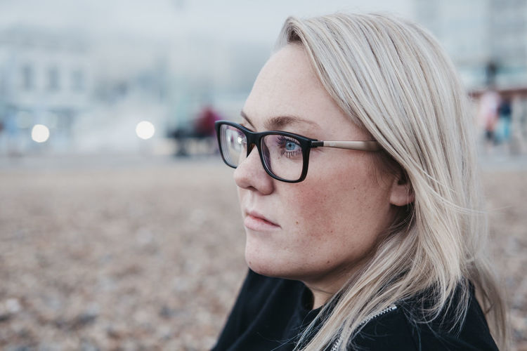 Blue Eyes Brighton Glasses Tranquility Adult Beach Beautiful Woman Blond Hair Blonde Hair Caucasian Caucasian Ethnicity Close-up Day Eyeglasses  Focus On Foreground Friendship Headshot One Person Outdoors Portrait Real People Relaxation Serene People Time To Reflect Young Adult