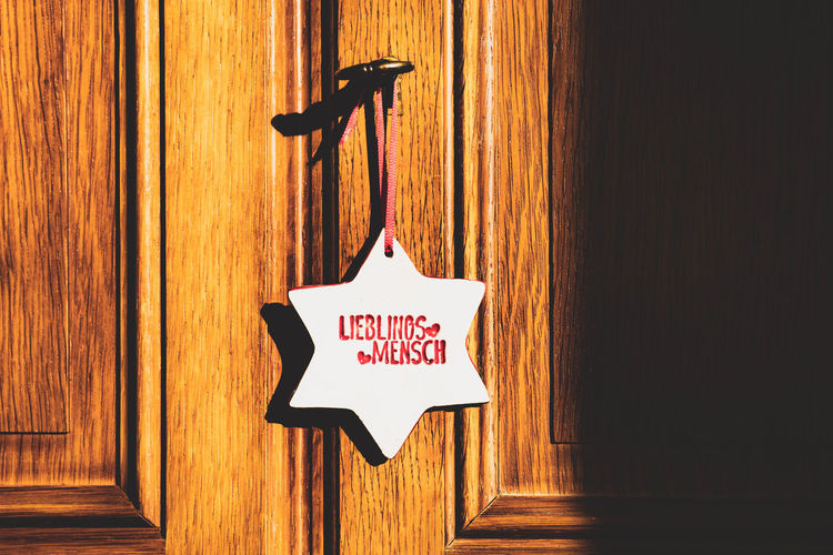 close-up of text on wooden door Brown Capital Letter Closed Close-up Communication Day Dezember Door Entrance Hanging Indoors  Lieblingsmensch Message No People Pattern Sign Stern Still Life Sunlight Text Wall - Building Feature Western Script Wood - Material