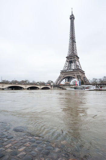 Tower Eiffle water flood in Paris, France Built Structure Architecture Sky Travel Destinations Water Tourism Tower Travel Tall - High City History The Past Building Exterior Nature Bridge Day River Bridge - Man Made Structure No People Arch Outdoors Spire