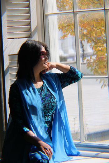 Woman looking towards window while sitting at home