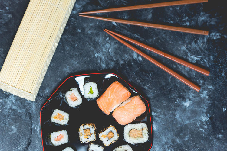 sushi Directly Above High Angle View Chopsticks Close-up Sushi Salmon - Seafood Rice - Food Staple Seafood Tuna Prepared Food Served Japanese Food Pastry Salmon Sashimi  Serving Size Still Life Fillet