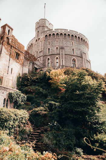 Windsor Castle Britian England Castle Architecture Built Structure Building Exterior History The Past Plant Tree Building Nature Travel Destinations Sky Day Low Angle View Travel Tourism Ancient No People Old Growth City Outdoors Ancient Civilization