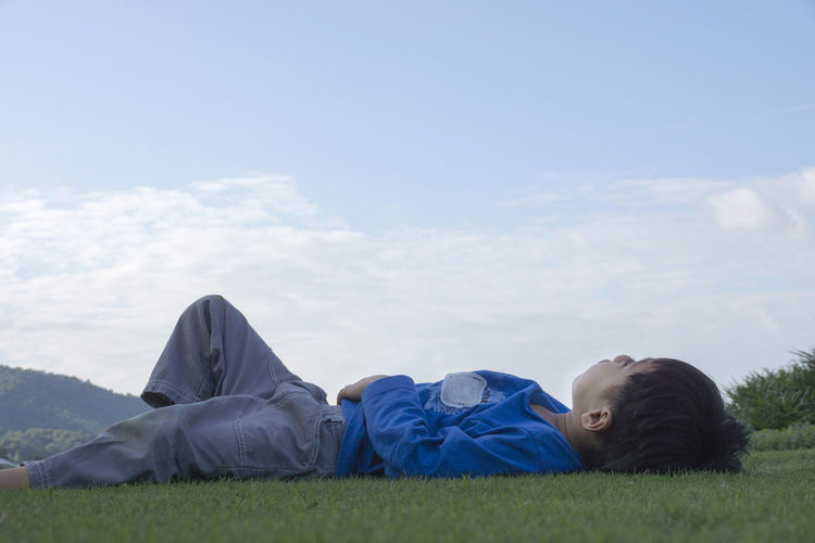 Mon son happiness Beauty In Nature Boys Cloud - Sky Day Grass Leisure Activity Lying Down Nature One Person Outdoors People Real People Relaxation Sky Tranquility