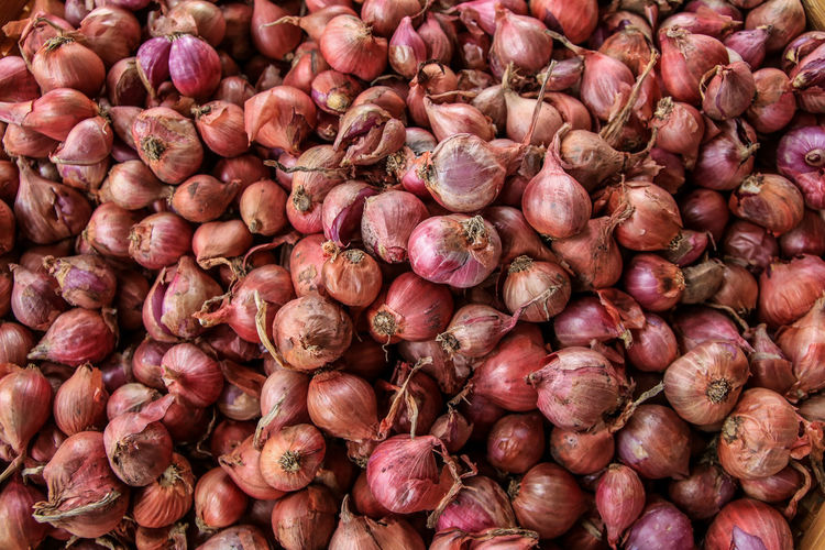 Full frame shot of onions for sale at market stall