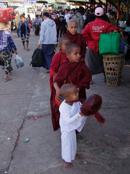 Four Young Novices with Alms Bowls at Mount Kyaiktiyo (Golden Rock) Alms Bowls Buddhism Buddhist Culture Buddhist Monks Composition Four Monks Full Frame Full Length Incidental People Kinpun Monks Mount Kyaiktiyo Mount Kyaiktiyo Pagoda Myanmar No Shoes Novices Outdoor Photography Shade Tourism Tourist Attraction  Tourist Destination Traditional Clothing Travel Destination Young Children Young Monks