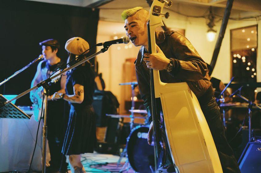 Singing Playing Music Only Men Performance Arts Culture And Entertainment Musician Bass Instrument Bass Guitar Doublebass Rockabilly Rockabilly Style Candid People Men Unioncamp Bangkok Thailand. Bangkok Fleamarkets