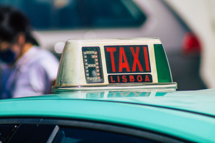 Close-up of taxi in city
