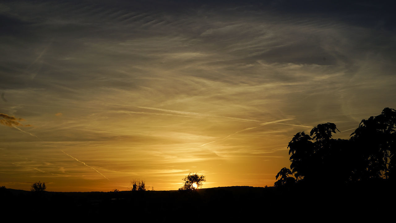 SILHOUETTE LANDSCAPE AGAINST SKY DURING SUNSET