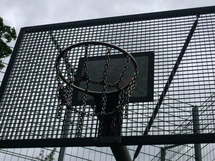 Athleisure Basketball - Sport Basketball Hoop Built Structure Close-up Cloud Cloud - Sky Day Design Geometric Shape Low Angle View Metallic Modern No People Outdoors Sky Sport Sports In The City Sports Photography Team Sports ArtWork Focus Relax Time  Leisure Activity The Color Of Sport