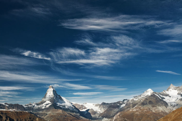 Matterhorn from Swiss Alps, Europe. Alps Beauty In Nature Cloud - Sky Extreme Terrain Landscape Matterhorn  Mountain Mountain Range Nature No People Outdoors Sky Snow Swiss Alps Switzerland
