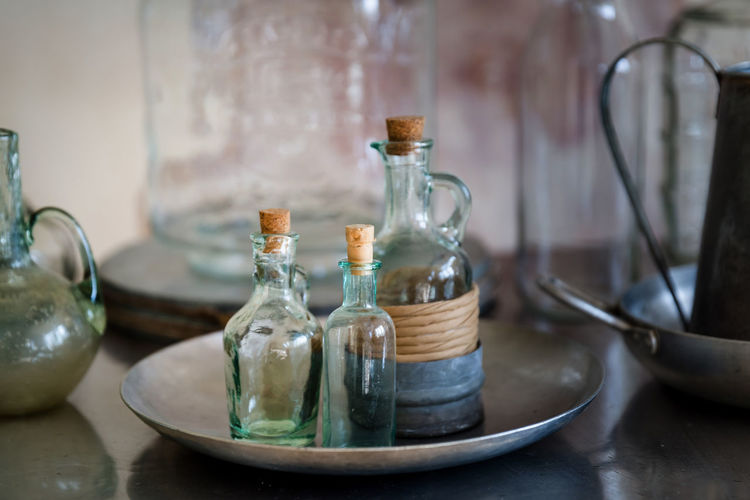 Close-up of bottle in metallic plate on table