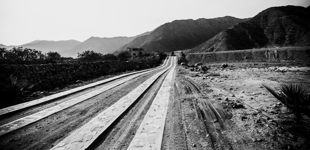 Sand and Black: Escape the Trace Welcome To Black Mountain The Way Forward Rail Transportation Transportation Landscape Clear Sky Railroad Track Day Nature Outdoors No People Sky Tree Scenics Beauty In Nature RoadBlackandwhite Racing