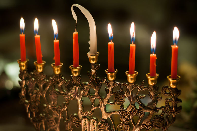 Close-Up Of Lit Candles On Candlestick Holder