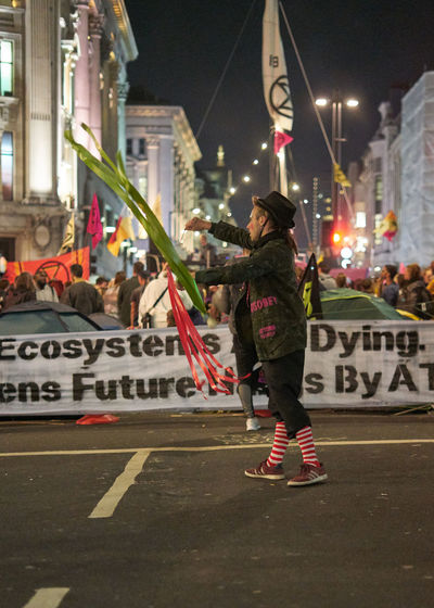 Extinction Rebellion Protest Climate Climate Change London Oxford Circus Ecosystem  Save The World Savetheplanet Green Green Green!  Real People Protesters Protesting Spinning City Street Text Night Road Communication
