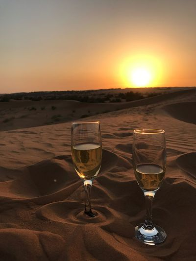 Sunset Wineglass Wine Alcohol Sun Drink White Wine Sky Drinking Glass Food And Drink Sunlight Scenics Sand Nature Refreshment No People Silhouette Outdoors Vacations Beauty In Nature champagne desert al maha The Traveler - 2018 EyeEm Awards