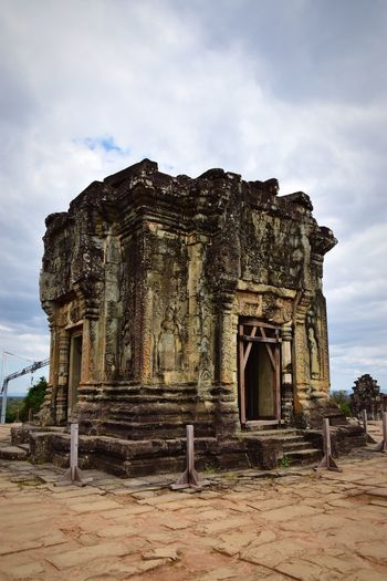 Old ruins of temple against cloudy sky