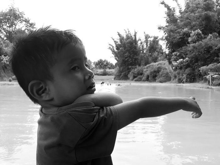 Cute boy looking away in water