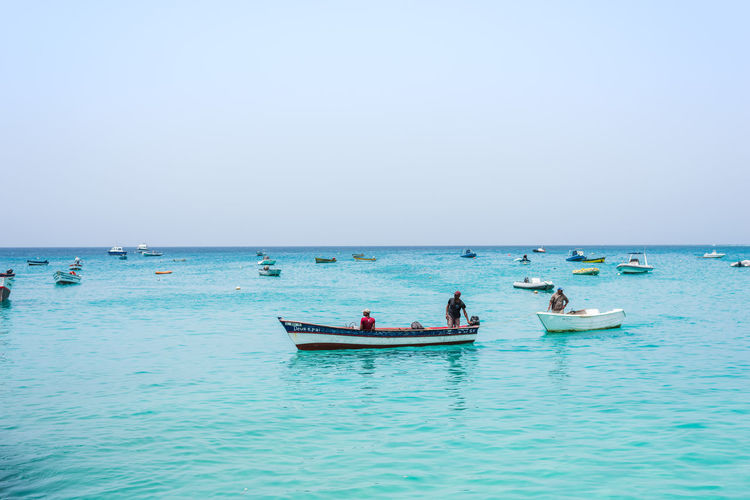 Boat Fishing Travel Destination Fishing Boats Mode Of Transportation Beauty In Nature Sea Water Nautical Vessel Horizon Over Water Horizon Sky Blue Day Turquoise Colored Blue Sky Summer Africa Cape Verde Cape Verde Beach