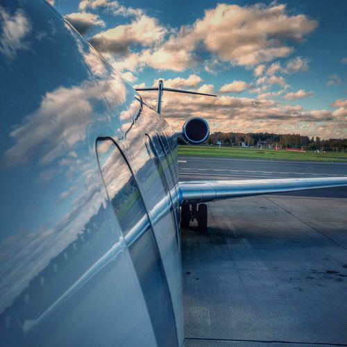 Airplane on runway against sky