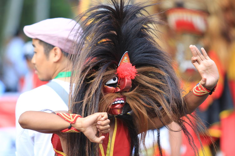 Man Dancing In Traditional Clothing