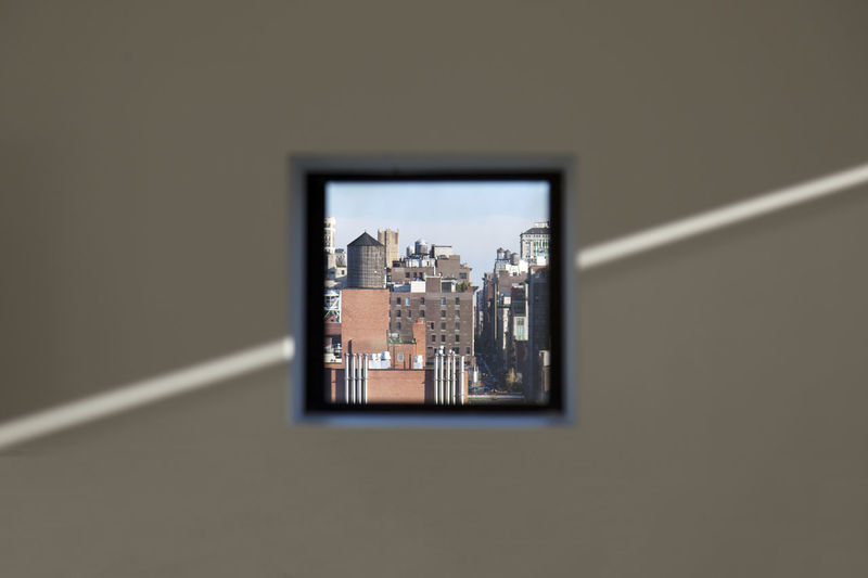 Close-up of cityscape seen through window