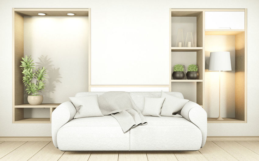 White sofa on hardwood floor against wall at home