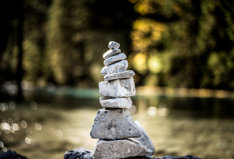 Close-up of stone stacked against defocused background