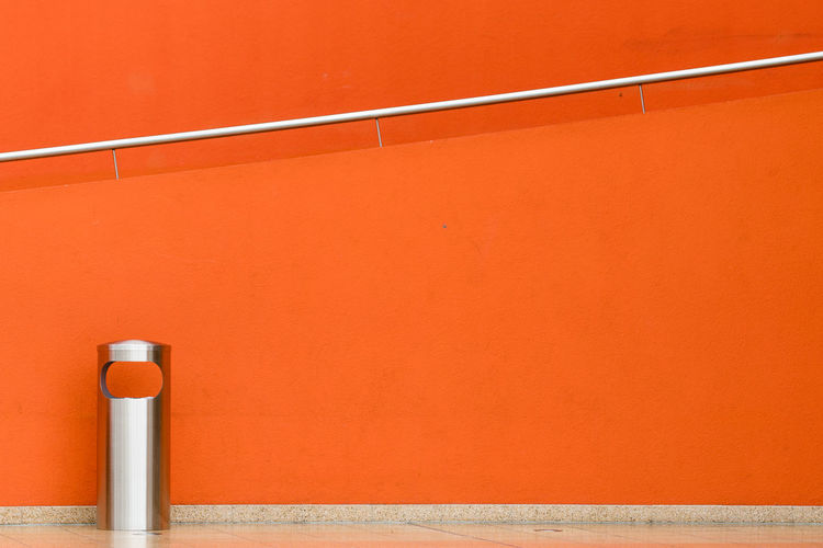 Railing on orange wall