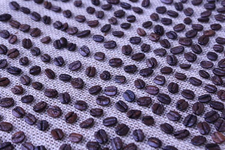Full frame shot of coffee beans on burlap
