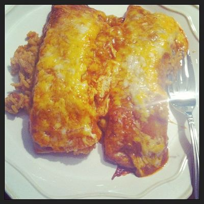 Chicken enchiladas over tex-mex rice w/ refried beans and chips and salsa. Deliciousness Fiestainmymouth Stuffed