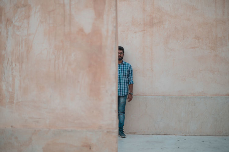 Half of Man Architecture Ijas Muhammed Photography Wall Architecture Backgrounds Building Exterior Built Structure Casual Clothing Concrete Contemplation Front View Full Length Half Leisure Activity Looking Men Model Obstacle One Person Outdoors Standing Wall Wall - Building Feature Young Adult Young Men