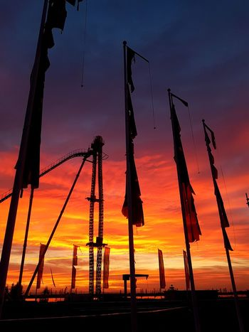 Sunset Sky Silhouette Architecture The Week Of Eyeem Mirabilandia🎡🎢🎠 Mirabilandia Amusement Park EyeEmNewHere No People Tranquility Orange Color Orange Sky Bandiere Flags In The Wind  Flags Old Flag Rollercoaster Divertical