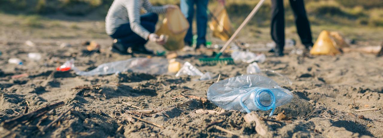 Close-up of plastic bottle on land