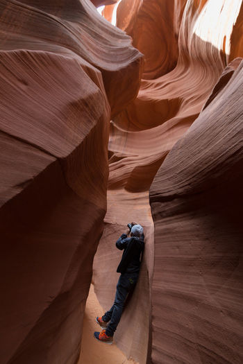 Man walking in the Lower Antelope Canyon in Page, Arizona, USA Antelope Canyon Arizona Beautiful Nature Beauty In Nature Explore Geology Get Outside Landscape_Collection Lower Antelope Canyon Man In Nature Nature Lover Nature Photography One Person Outdoors Red Rocks  Rock Formation Rock Formations Slot Canyon The Great Outdoors The Great Outdoors - 2016 EyeEm Awards The Great Outdoors With Adobe Travel Destinations Travel Photography