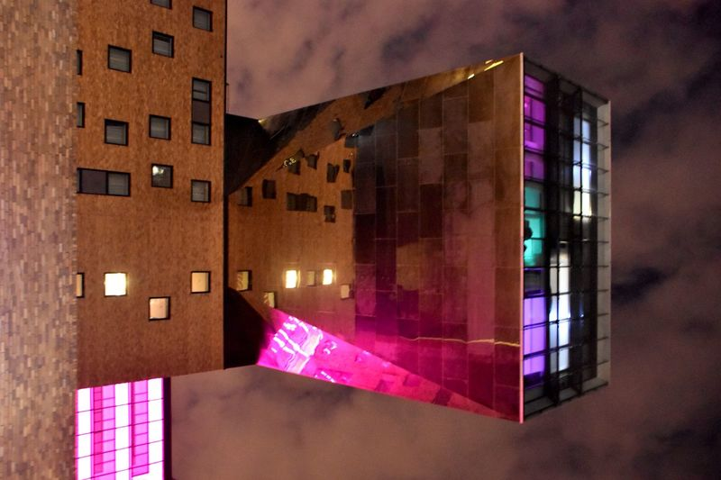 is_cantilevering. Mirror Reflection Reflection Looking Up Lookingup Façade Family Trip Walking Around The City  Architecture Architecture_collection Architecturelovers Cantilever Berlin_2018 Berlin IPhoneography Nhow Berlin TCHOBANVOSS Architecture Built Structure Building Exterior Building City Window No People Wall - Building Feature Illuminated Multi Colored Pink Color House City Life
