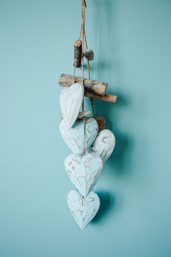 Close-up of rope hanging against blue wall